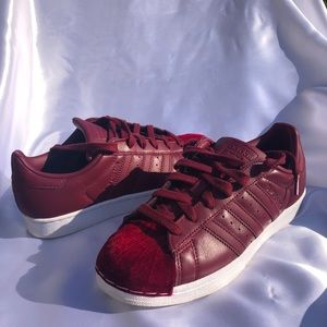 Adidas burgundy with a velvet to detail!